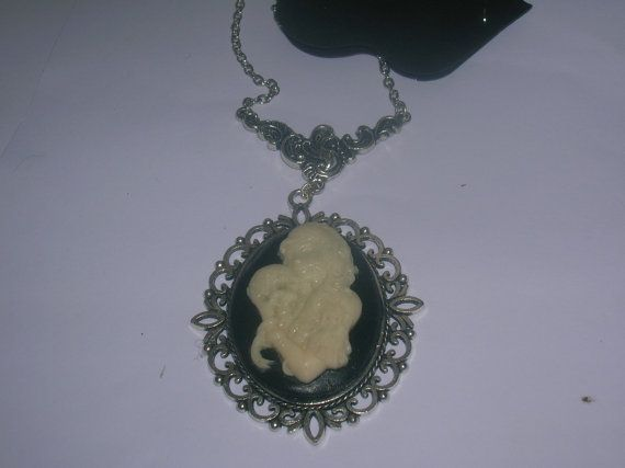 day of the dead lady with skull cameo pendant. glow in the dark