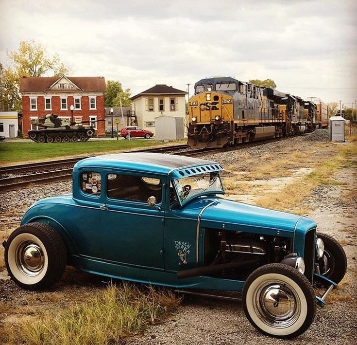 Two of my favorite things! Hot Rods and trains...