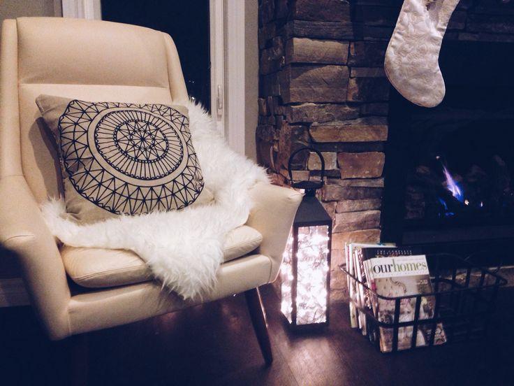 rustic holiday vibes. lights. fur. lantern. fireplace. stockings. stone.