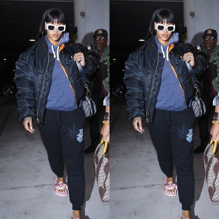 Rihanna Jacquie Aiche sweet leaf joggers, Vetements x Alpha Industries reversible black quilted bomber jacket, Raen flatscreen white sunglasse, Fenty x Puma pink bow satin slides