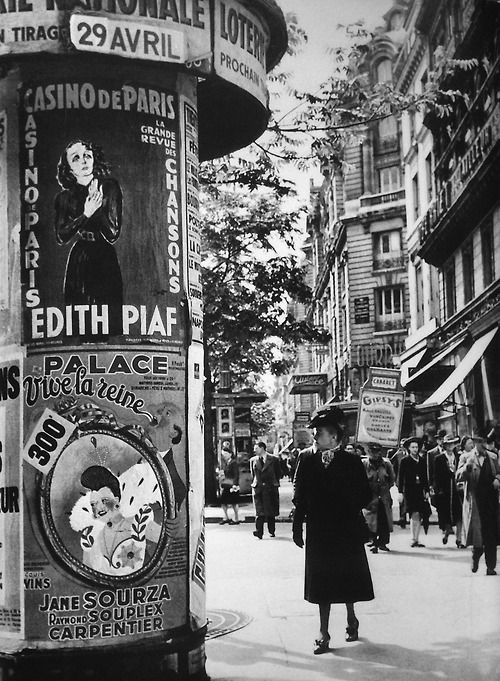 """André Zucca - Paris 1943. S) Just saw """"Posters of Paris"""" exhibit at the DMA last night -- posters from probably 50 years before this photo was taken. Part of the exhibition literature said Paris used to be COVERED with posters; they were put anywhere you could slap one up, but now, the only posters you see in the city say, """"No Posters!"""" Maybe graffiti is the new poster?"""