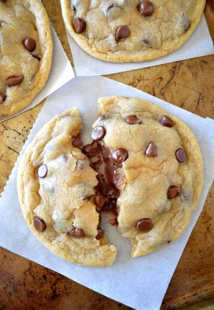 Soft & Chewy Nutella Stuffed Chocolate Chip Cookies - super chewy, bakery style, huge nutella stuffed chocolate chip cookies! So unbelievably soft, moist, and CHEWY!