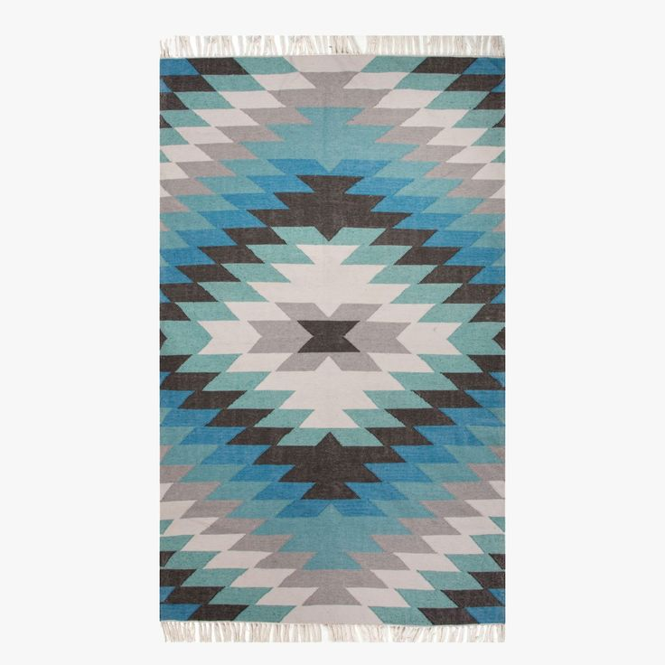Our Blue Mojave Indoor Outdoor rug is inspired by the traditional kilims of the desert region. Designed in shades of blue ranging from turquoise to aqua.