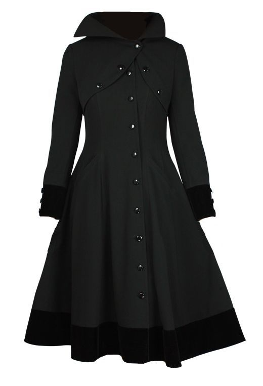 This coat has a fit and flare cut. The high collar is accented with buttons. The only working buttons are the ones that run from the neck on the faux shrug down the side of the coat. Asymmetric closure over the heart. Asymmetric hemline, two side pockets. The length comes down to below the knees. Wide button accent cuffs. Button front closure. Fully lined.