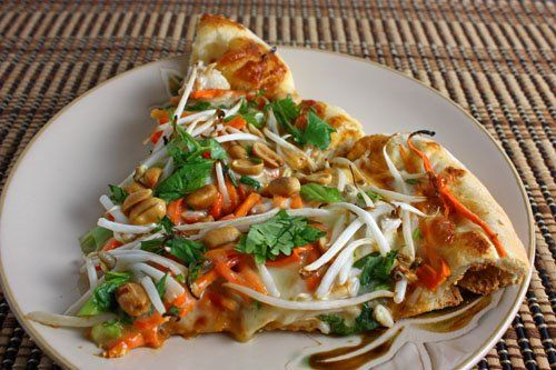 Thai Chicken Pizza with Spicy Peanut Sauce.. Liked it, only it needs different ingredients on it. Maybe red onions and different cheese. And needs more sauce.