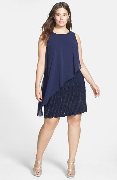 Free shipping and returns on Xscape Chiffon Overlay Beaded Hem Dress (Plus Size) at Nordstrom.com. A sleeveless shift enchants with the floaty elegance of a sheer chiffon overlay and the midnight sparkle of tonal beading streaming down the scalloped skirt.