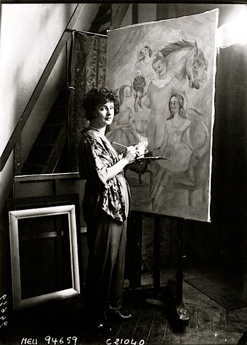 """Irene Lagut in her studio, Paris, 1922.  """"In the spring of 1916, Picasso fell madly in love with Irene Lagut… The affair was on and off until the end of 1916, when they decided to marry. Then at the last minute, when they were going to meet family in Barcelona, she returned to her previous lover in Paris, a woman. It is also said Lagut had been kept by a Russian grand duke in Moscow… She and Picasso became lovers again in 1923 and one of his most famous works, The Lovers (1923), showing a…"""