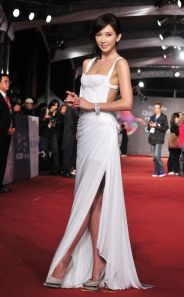 CHILING LIN 林志玲 WEARING VERSACE – THE 49TH GOLDEN HORSE AWARDS.  I like the look of the dress but the straps look cheap with the velcro sides but I guess that's how you get 'em on.  Also, I a pop of color in the shoes, like magenta would be awesome.