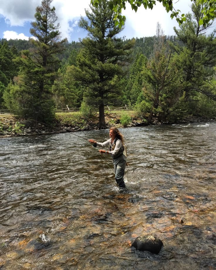 Although it is often characterized as a man's sport, fly fishing is a favorite with women and men at The Ranch at Rock Creek in Montana. Ranch Guide Regan leads a women's fishing excursion during a girl's weekend at the luxury guest ranch.