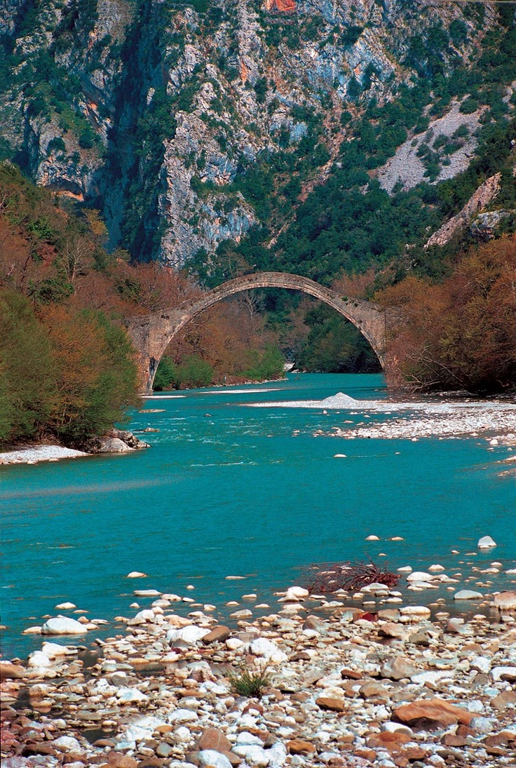 Old bridge of Plaka over Arachthos river. A typical landscape of Epirus, Northwestern Greece. This bridge, built exclusively with stones in the 19th century, is considered to be the largest amongst the Balkan countries.