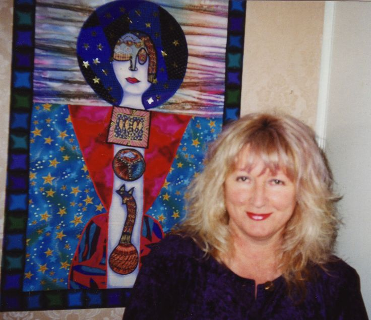 Sylvia Convey with one of her art quilts.