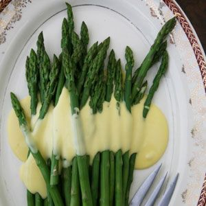 "JULIA CHILD's famous ""Asparagus with Hollandaise Sauce""...as seen on ...  http://www.saveur.com"