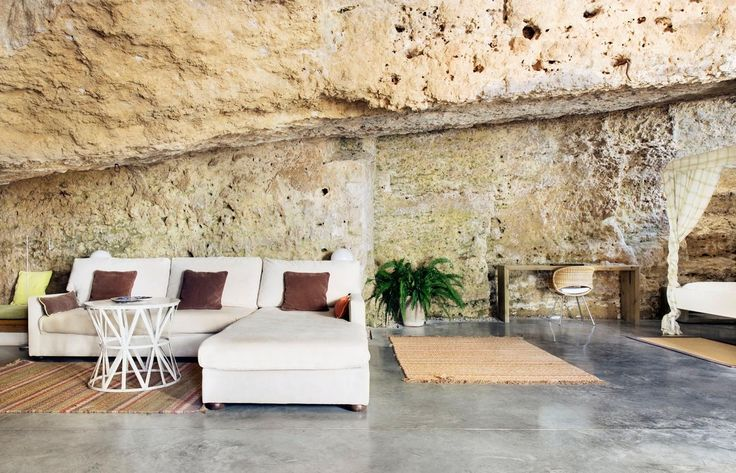 """Built into the side of a calcarenite stone quarry, Casa Tierra, informally known as """"The Cave House,"""" is a fusion of human and natural architecture.  Sitting in the foothills of Sierra Morena in Spain, its visual beauty is matched by its beautiful weather, which rarely deviates from 70F degrees year round."""