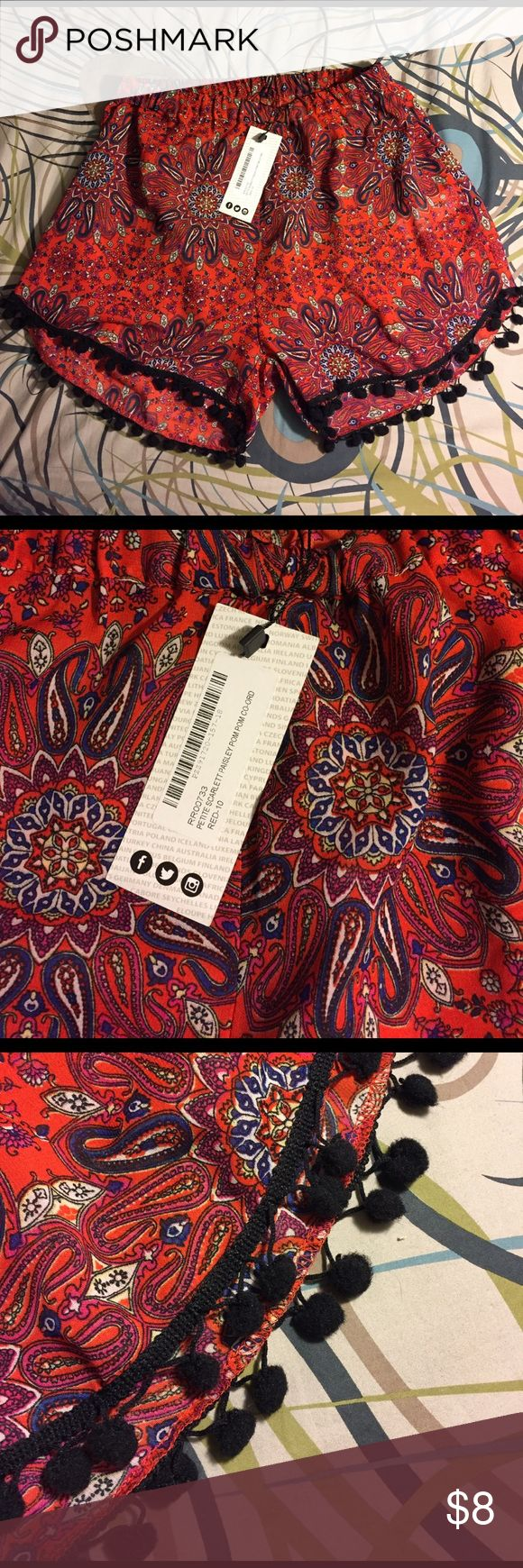 NWT Red and black paisley print women's shorts Adorable flowy red and black paisley printed women's shorts with black pom pom details on the bottom. Great for the summer, for the beach, and for vacation! Would fit small or xsmall! Boohoo Petite Shorts