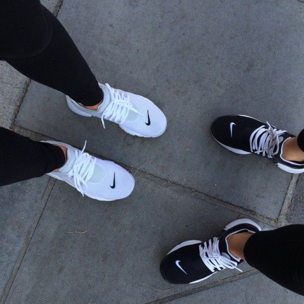Wheretoget - Nike white sneakers and Nike black sneakers
