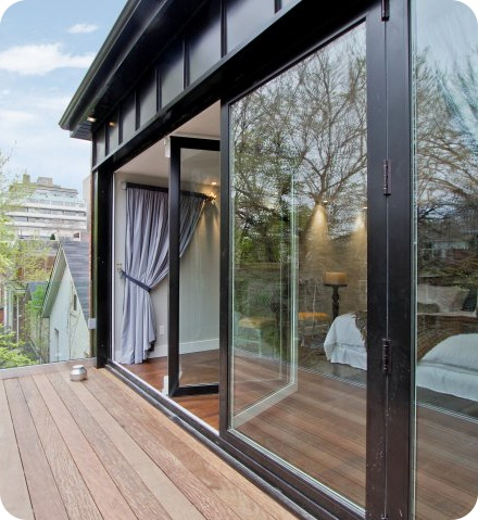 Floor to ceiling windows glass doors tiny house for Floor to ceiling glass