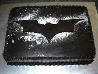 Black icing, superhero template, icing sugar. BAM!