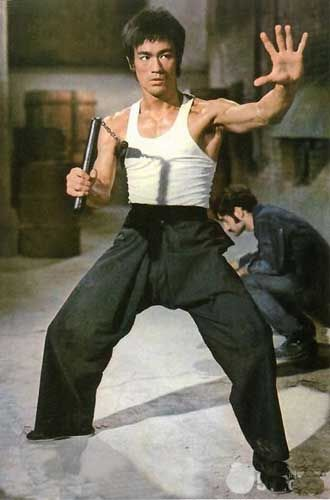 Bruce Lee in Return of the Dragon (Way of the Dragon).  The world of karate--even the word itself--was  introduced to me through this man. He made fight scenes flow like a choreographed dance sequence. Like the resourceful MacGyver, Lee could take ANY object and make it into a weapon. And the first FIIIINE Asian man I ever saw. Such a cool dude.