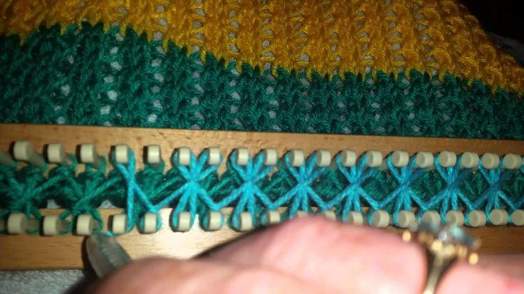 Star stitch on a long knitting loom. rake