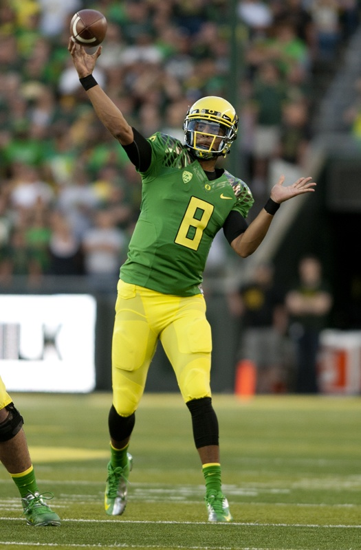 Oregon Ducks' classic old school uni with Green O on yellow helmet. Now days rarer than an endangered species of duck.