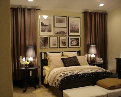 The curtains add texture and interest to the otherwise plain wall. I also like the picture collage above the bed.