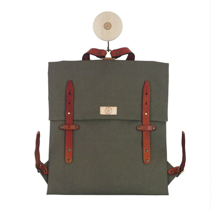 "The RU scout pack, carries anything from your Mac notebook (13""or 15"") to your everyday utilities. It contains a detachable notebook bag and extra utility bag for smaller items. The straps are made from carefully selected vegetable tanned cowhide leather, they are hand dyed and details are hand stitched. The outer bag is made from 3M scotch guard water repellent high quality canvas.      Dimensions: 36 cm x 39 cm  Manufacturing: 1-7 working days Standard Delivery:  South Africa/Domestic 2-4…"