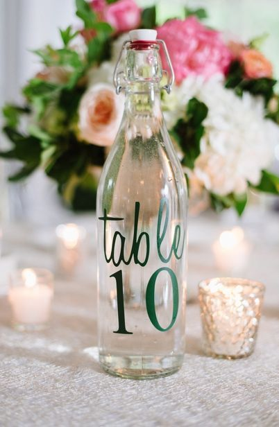 Chic and unique bottle table number wedding reception centerpiece; Featured Photographer: Natalie Franke Photography