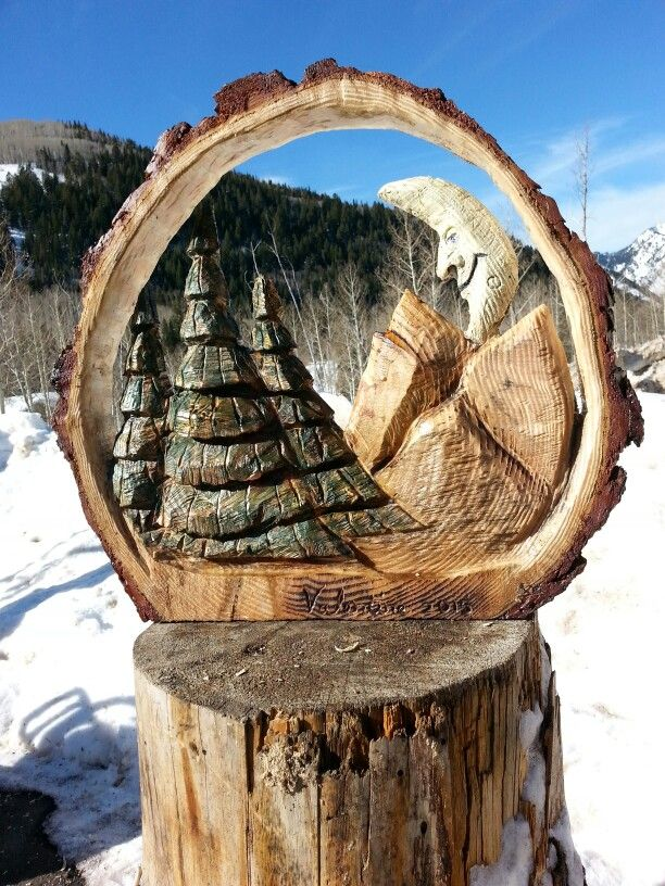 Beautiful day in the mountains chainsaw sculptures