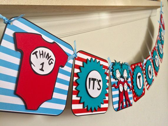 So fun and so cute Thing 1 and Thing 2 Its twins baby shower banner. Each layer is popped out for a 3-D effect. There are hand-drawn details throughout the banner to add more personality. Each square is 6 inches tall. thing 1 and 2 are just a little over 6 inches. This will be a great addition to your Dr.Seuss themed baby shower!! **Note: You will receive the original red and blue banner when you order unless you specify a different color. Ribbon and paper patterns are subject to change…