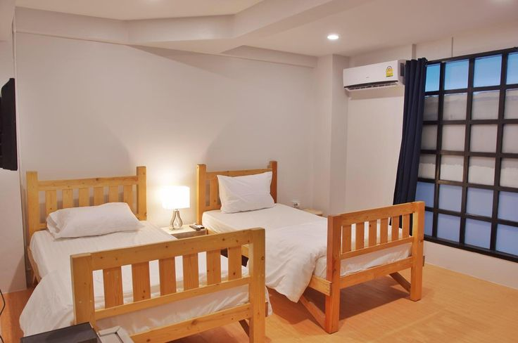 Bangkok Thailand |  Two single wooden bed with a hidden cat waiting for you to find out.