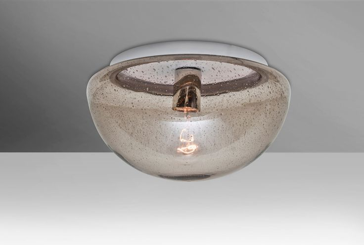 The 8490 Series is a ceiling semi-flush design composed of a transparent glass diffuser, with an interesting bubble pattern blown randomly throughout the glass. The pleasing play of light through each shade's bubble accents make for a striking affect along with the prominent display of the lamp filament behind the glass.