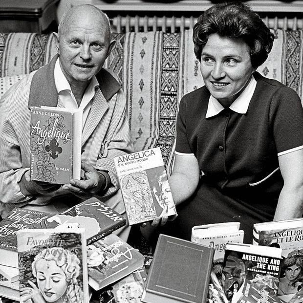 Anne & Serge Golon with their collection of Angelique books.