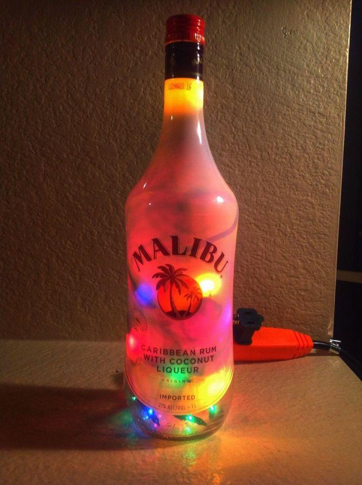 17 best images about wine bottle lights on pinterest for Liquor bottle art