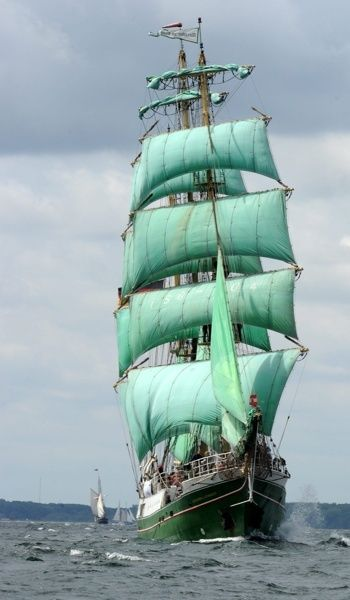 It's a ship with green sails wow. A little darker, and a bit smaller, and it would be perfect.                                                                                                                                                                                 More