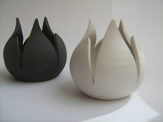 Tea-light holders : Tulips.They are made by black stoneware.1260C. Tea-light candles can be placed inside them.