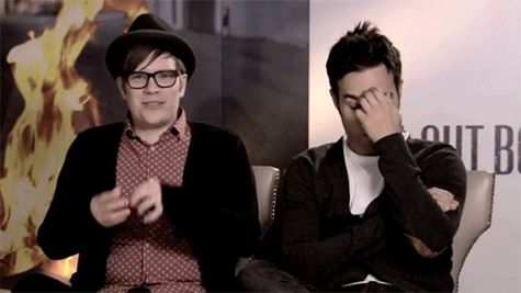 Pete and Patrick - Fall Out Boy. Looks like Patrick said something funny, because of Pete's expression lol.