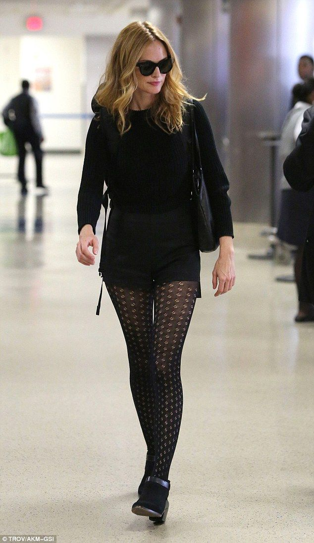 Amazing pins: The 47-year-old looked stunning in patterned tights and ankle boots...