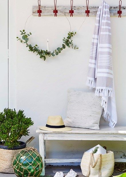 Christmas inspiration: beachy and bright - grab a little greenery from the garden and secure to wreath with florist wire.  Home Beautiful Magazine Australia