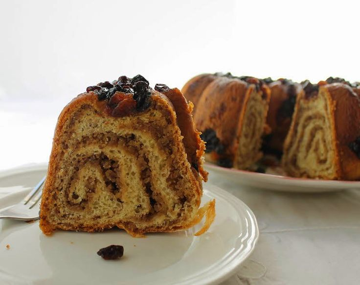 Povitica, pronounced pov-e-tee-za, in its original form, is yeast dough, stretched till it's very, very thin, then spread with a walnut filling and rolled up, Swiss-roll style and baked in a loaf tin.