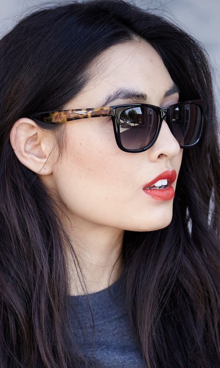 Classic wayfarer sunglasses with acetate frames and printed sides.
