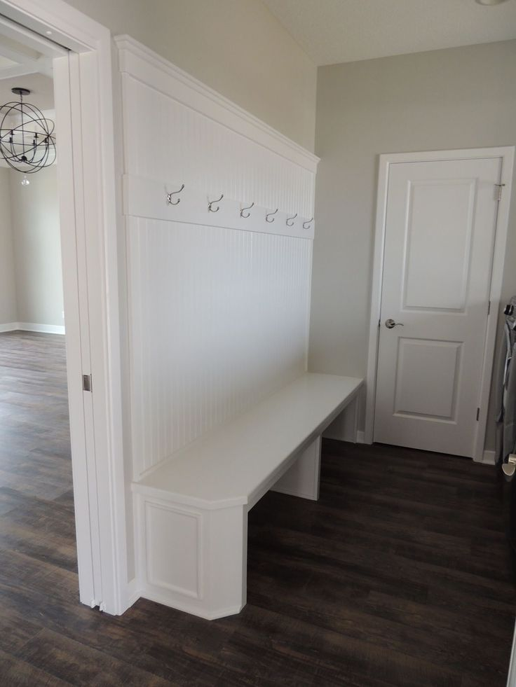 White bead board bench with hooks! Perfect for the entry off the garage. #benchseat #bench #benchwithhooks #whitebenchseat #mudroom #laundryroom #entryway #entrywaybench #whitebench #beadboard #beadboardbench