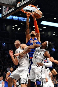 Barton Silverman/The New York Times  Tyson Chandler dunking over the Nets' Brook Lopez, left, and Gerald Wallace at Barclays Center