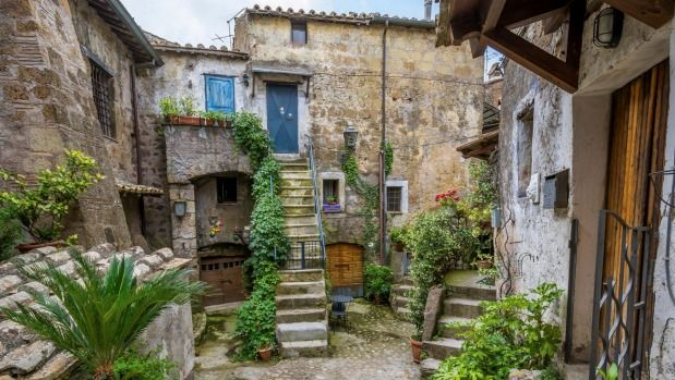 Calcata is a rabbit warren of cobbled streets, with tiny stone houses piled one on