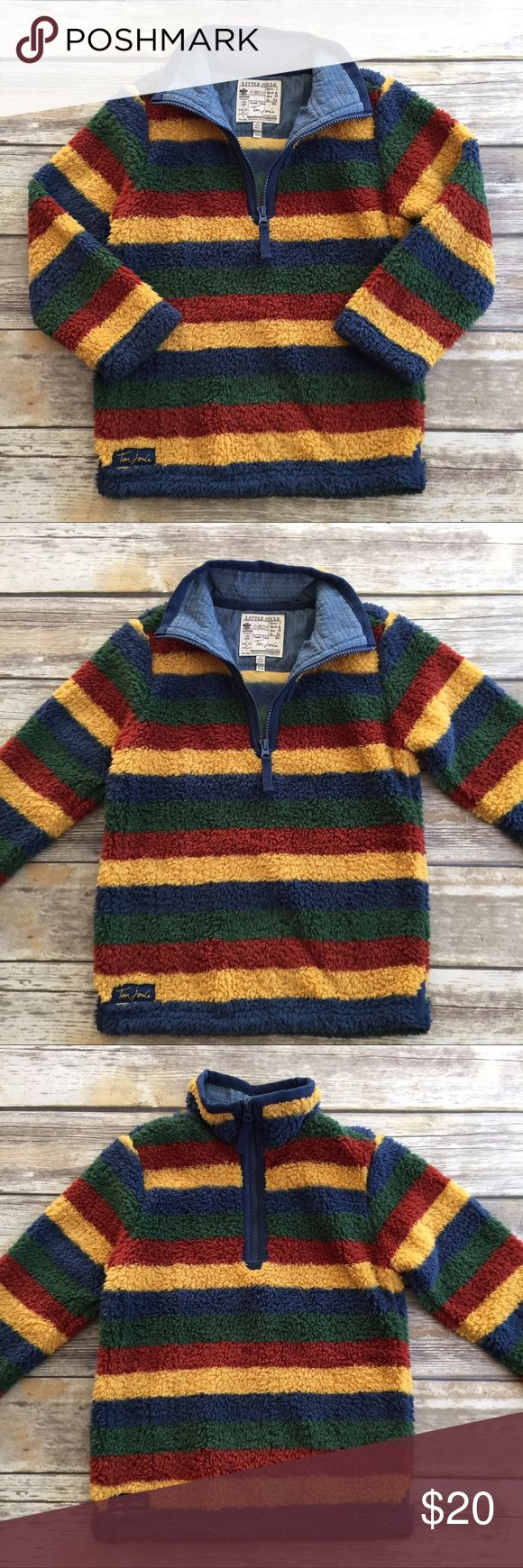 Little Joule Fleece Pullover This is the softest jacket you've ever felt. Zip up neck, stripes in mustard, maroon, green and blue, this jacket is perfect for fall. Did I mention soft? Joules Shirts & Tops Sweatshirts & Hoodies