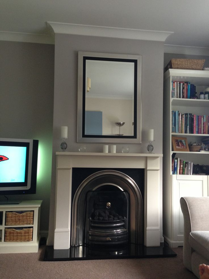 Grey Wall With Cream Fireplace