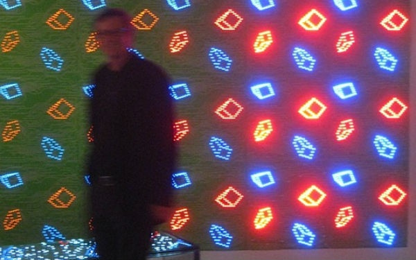 This high-tech wallpaper acts as a circuit board covered with small LED lights.