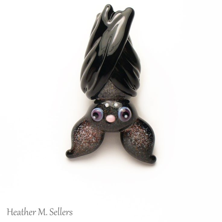Just hanging around.  A vampire bat lampwork glass bead.  The character is a one…