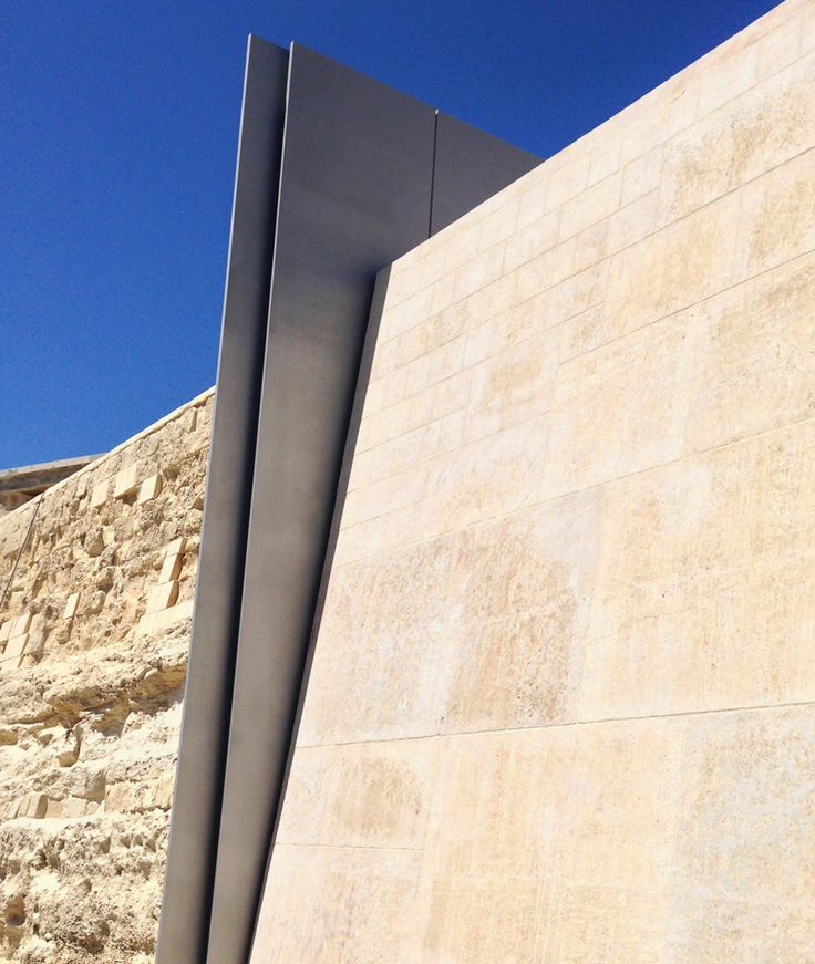 renzo piano clads valletta city gate with vast stone façade