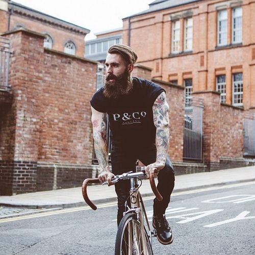 Ricki Hall on a bicycle full thick dark beard mustache undercut beards bearded man men mens' style bike bikes tattoos tattooed handsome