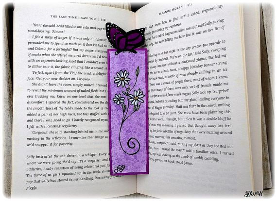 Purple bookmark with flower and a pretty butterfly.